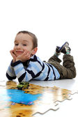 Boy doing a jigsaw, puzzle — Stock Photo