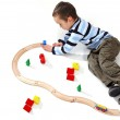 Boy playing with a train set — Stock Photo #16180355