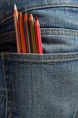 Crianças criativas, lápis coloridos no bolso — Fotografia Stock
