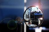 Reflection in the mirror shiny trucks — Stock Photo
