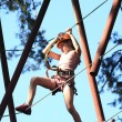 Teenager climbing a rope park, — Stock Photo