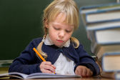 Child at school, girl in school working with abacus — ストック写真