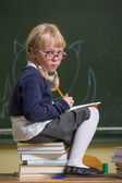 Child at school, girl in school working with abacus — Stockfoto