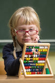 Child at school, girl in school working with abacus — Stock fotografie