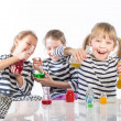 Stock Photo: Children learn chemistry, work in the chemical laboratory