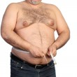 Fat man holding a measurement tape — Stock Photo #42963587