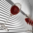 Foto Stock: Wineglass newton cradle
