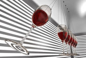 Wineglass newton cradle — Stockfoto
