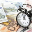 Clock and euro banknotes — Photo