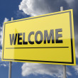 Road sign with word Welcome on blue sky background — Stock Photo