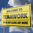 Road sign with words Welcome to teamwork on blue sky background — Stok Fotoğraf #25184251