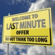 Road sign with words welcome to last minute offer — Stock Photo #26062529