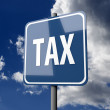Road sign Blue with word Tax — Stock Photo