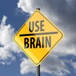 Foto Stock: Road sign Yellow with words Use Brain