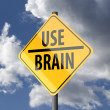图库照片: Road sign Yellow with words Use Brain