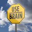 Road sign Yellow with words Use Brain — Foto Stock