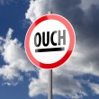 Road sign White Red with word Ouch — Stock Photo
