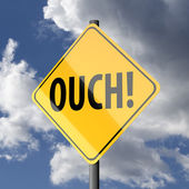Road sign Yellow with word Ouch — Stock Photo