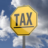 Road sign Yellow with word Tax — Foto Stock