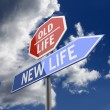 Foto Stock: New Life and Old Life Words on Red and Blue Road sign