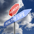 Illness and Healthy Life Words on Red Blue Road sign — Stock Photo