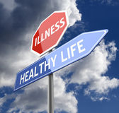 Enfermedad y vida sana palabras en rojo azul muestra del camino — Foto de Stock