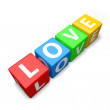 Love word made of colorful toy blocks — Stockfoto