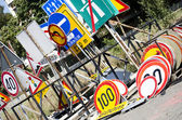 Stack of different old traffic road signs — Stock Photo