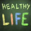 Healthy life words on green chalkboard background — Stockfoto