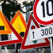 Stockfoto: Stack of old traffic road signs