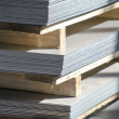 Sheet metal on wood palettes — Stock Photo