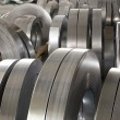 Sheet tin metal rolls in production hall — Stock Photo