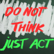 Do not think just act words on chalkboard backgruond — 图库照片