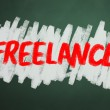 Freelance word on chalkboard backgruond — 图库照片