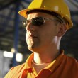 Worker with helmet and sunglasses — Stock Photo