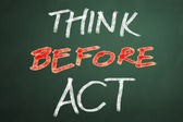 Think before act words on chalkboard backgruond — Stock Photo