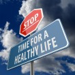 Stop and Time for a Healthy Life words on Road Sign — Stock Photo