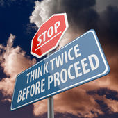 Stop and Think twice before proceed words on road sign — Stock Photo