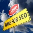 Time for SEO wors on Road Sign and Stop Sign — 图库照片