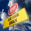 Use Your Brain words on Road Sign Yellow and Stop Road Sign — Stok fotoğraf
