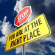 You are at the Right Place words on Road Sign and Stop Sign — Stock Photo