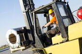 Forklift in front of production hall — Stock Photo