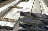 Sheet metal profiles in production hall — Stock Photo