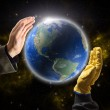 Hands of businessman and worker holding Planet Earth — Stock Photo #39080389