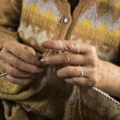 Stock Photo: Hands of older womknitting close up