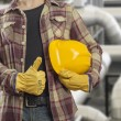 Stock Photo: Manual worker with helmet in front of production hall