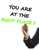 Businessman hand with felt tip marker writing text you are at the right place — Foto Stock