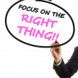 Stock Photo: Businessmhand with felt tip marker writing text focus on right thing