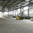 Stock Photo: Forklift in sheet metal production hall