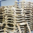 Stock Photo: Wooden pallettes in production hall